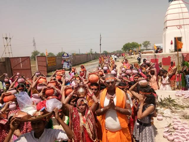 For organizing Kalash yatra with nine-day great yagya